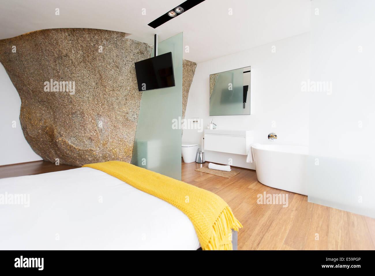 Sliding glass door of modern en suite bathroom - Stock Image