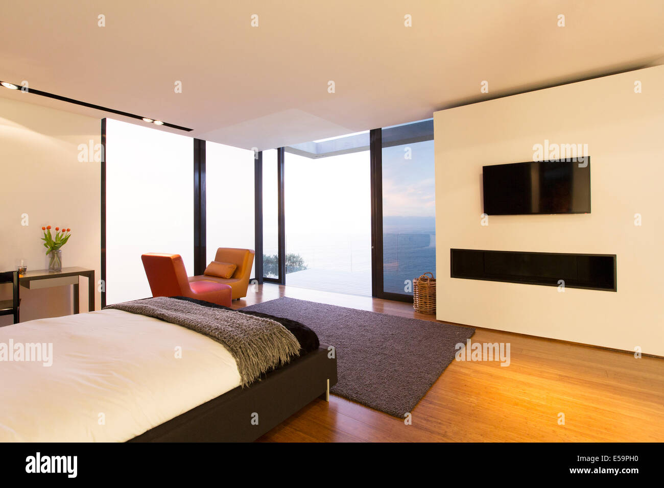 Bedroom and glass doors of modern house - Stock Image