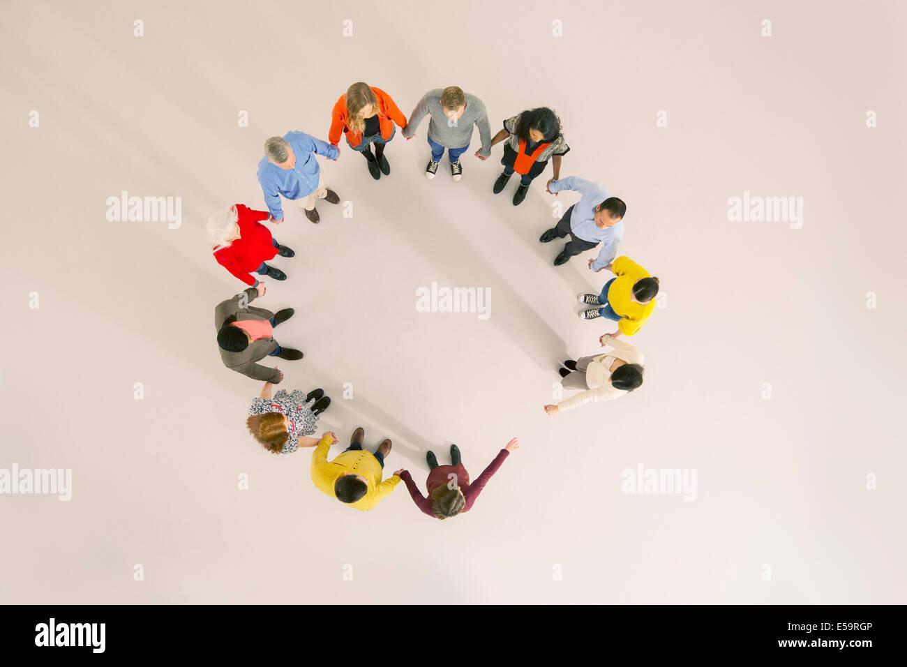 Diverse group forming circle - Stock Image