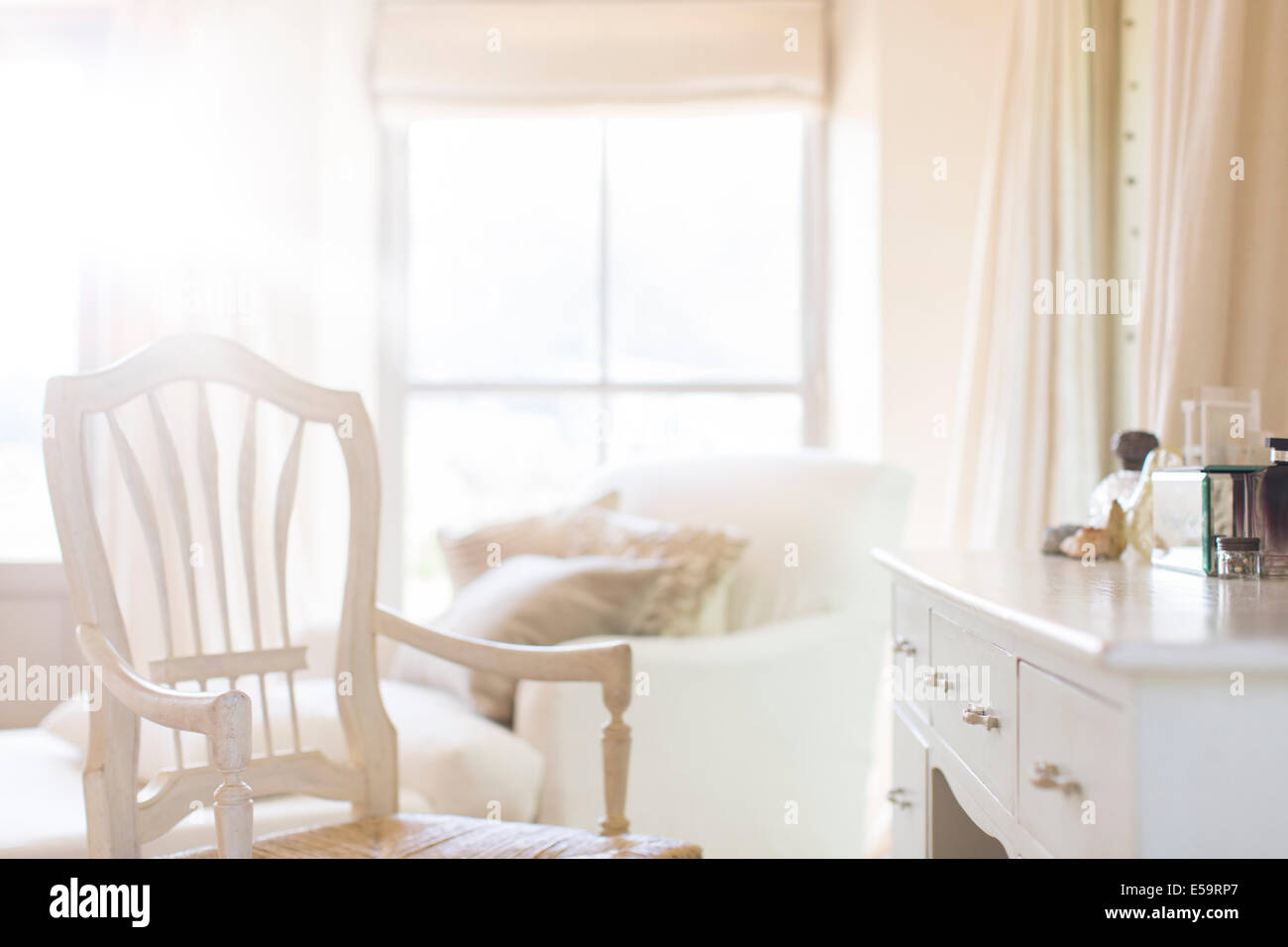 Armchair at vanity of rustic house - Stock Image