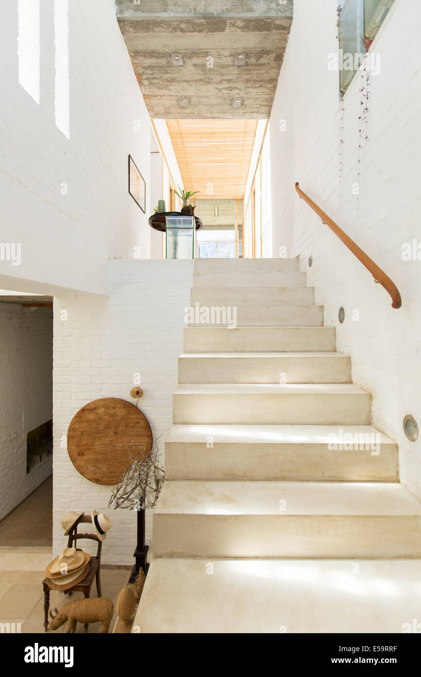 Staircase in rustic house - Stock Image