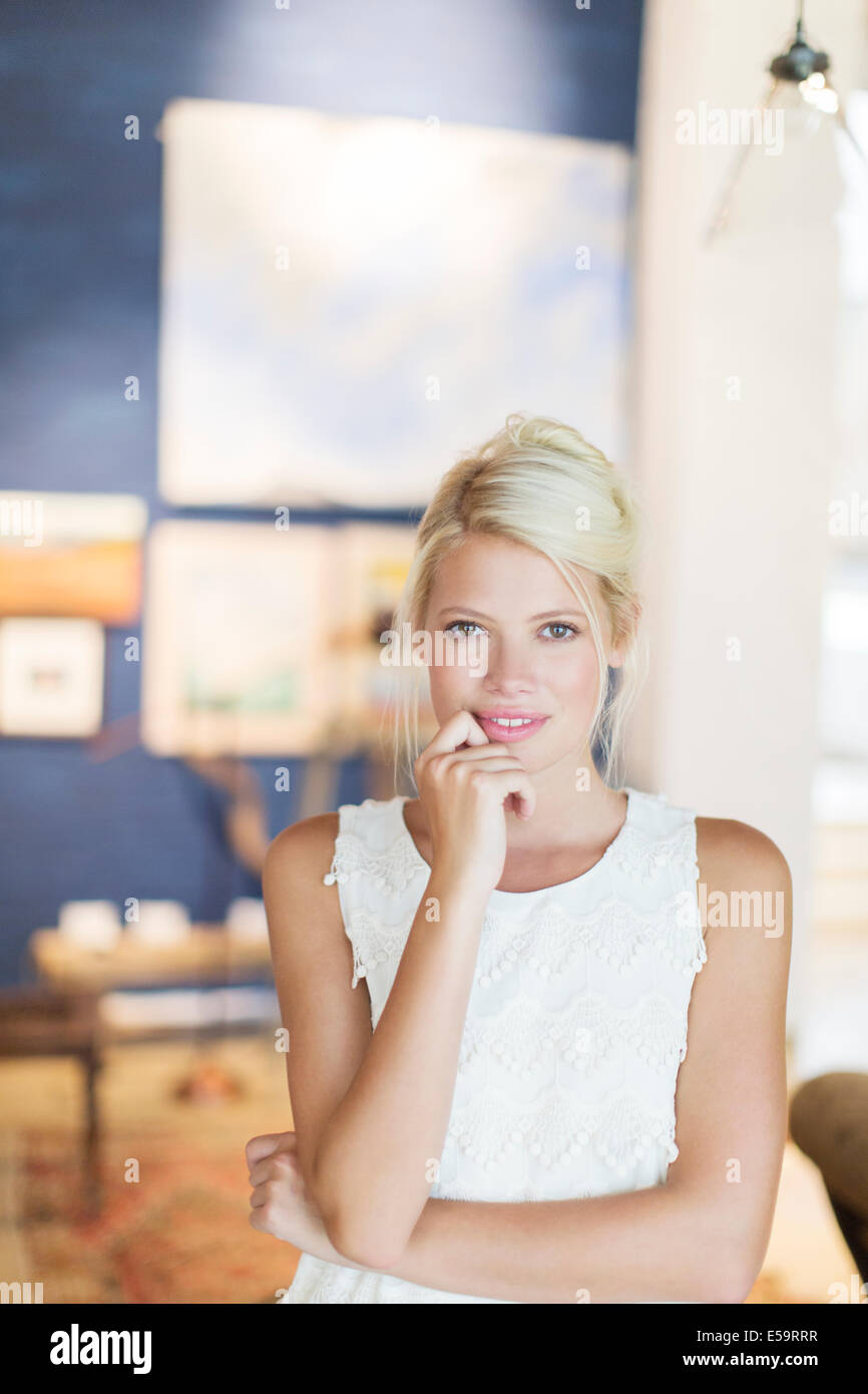 Woman holding her chin in hand - Stock Image