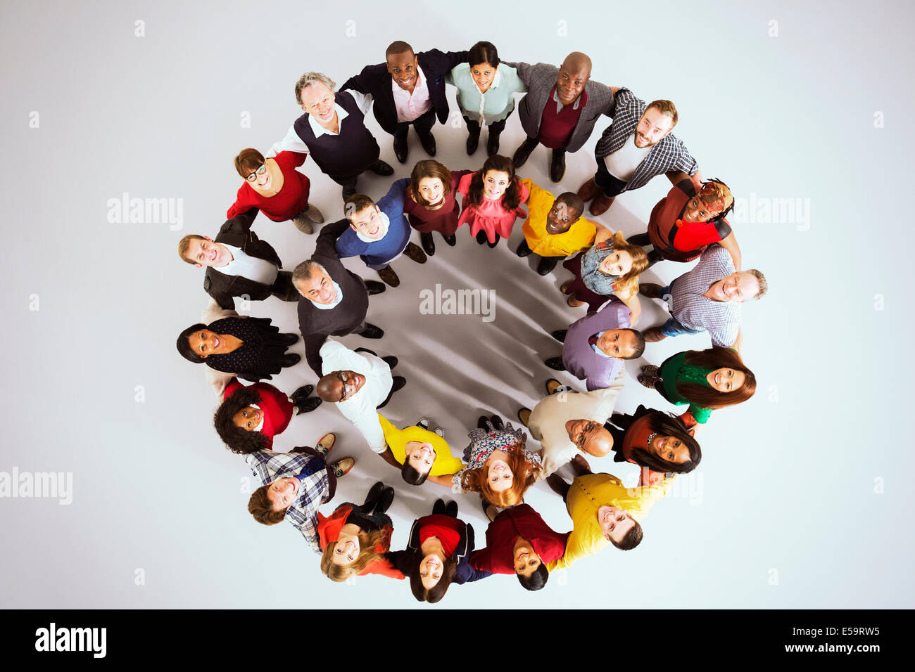 Portrait of confident business people in circle - Stock Image