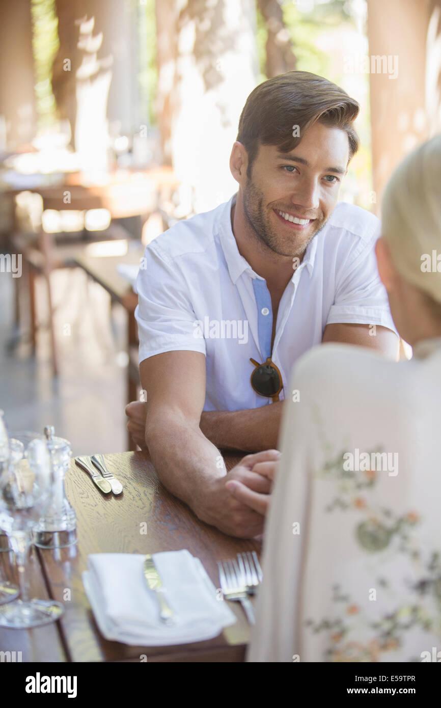 Couple talking in restaurant - Stock Image