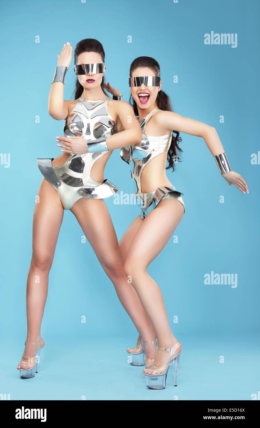 Night Life. Two Glamorous Women Dancers in Fantastic Masks - Stock Image