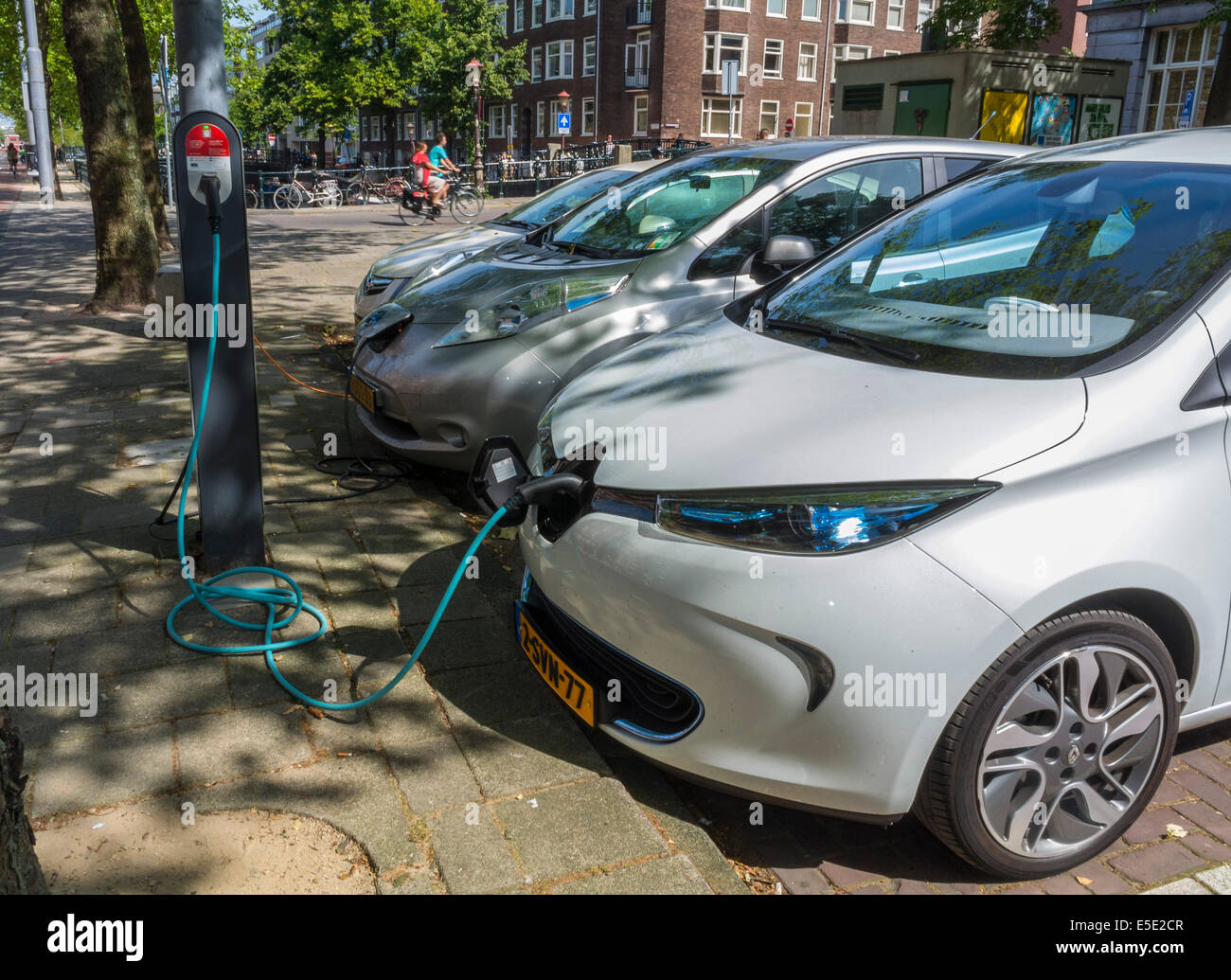 amsterdam, Holland,  The Netherlands, Parked, Electric Cars, Batteries Being Charged on Street Parking lot Stock Photo
