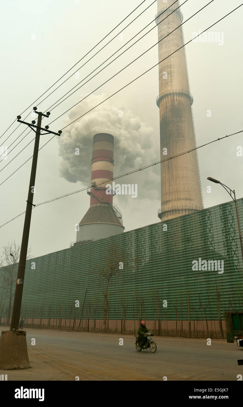 Black smoke emitted from the chimney of a private iron and steel factory in Tangshan, Hebei province, China. 26 - Stock Image