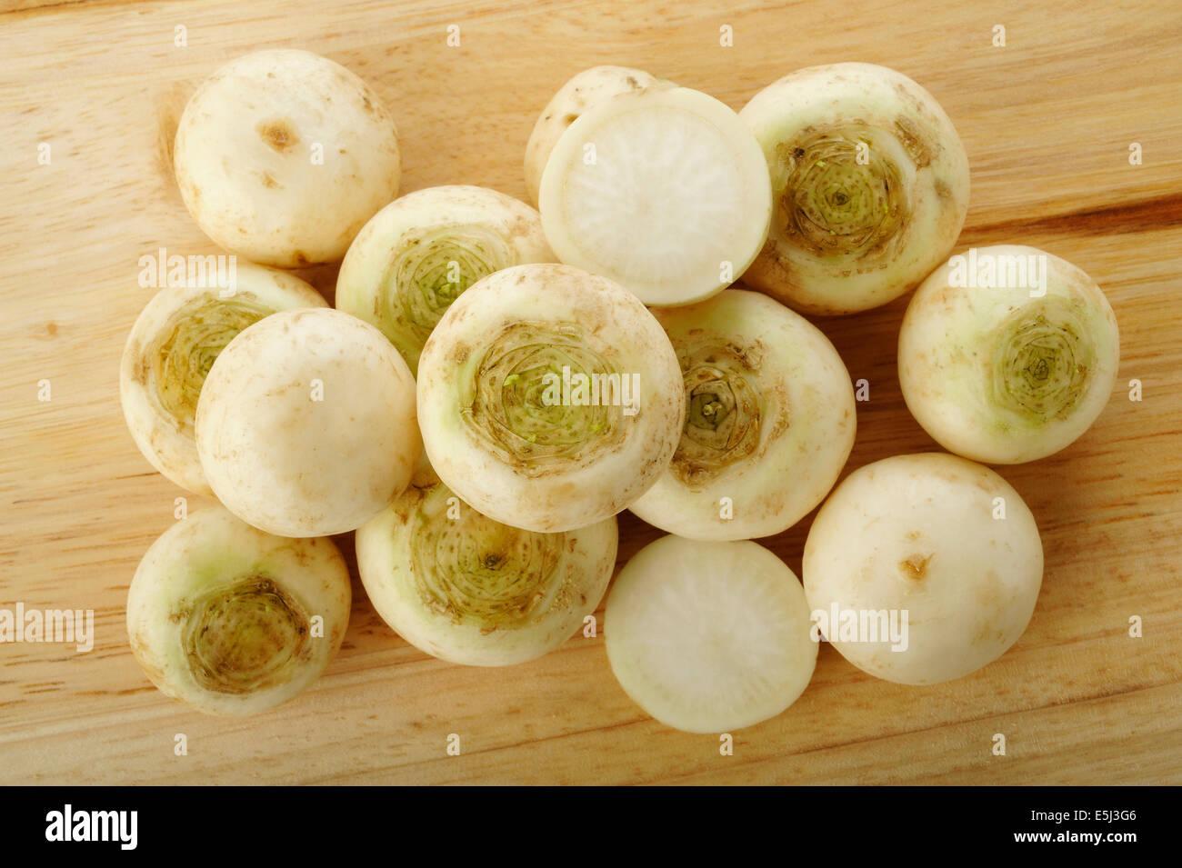 turnip on wooden kitchen board - Stock Image