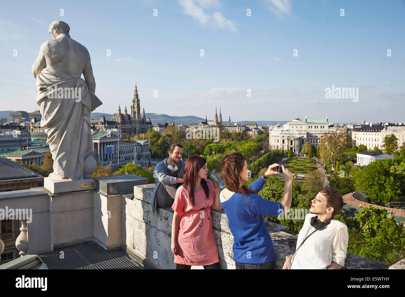 Group of young adult tourists taking pictures, Vienna, Austria - Stock Image