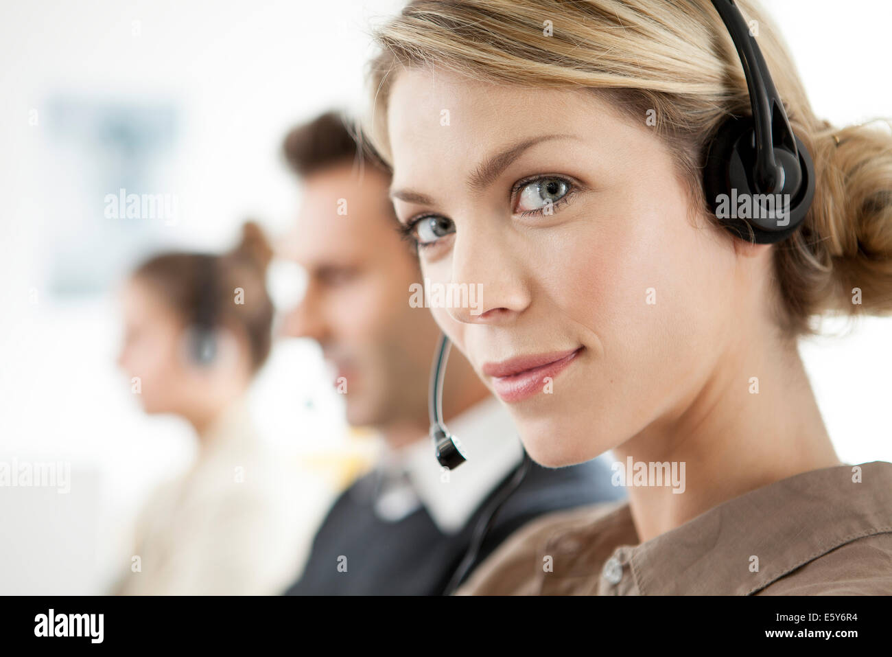Telemarketer working in call center - Stock Image