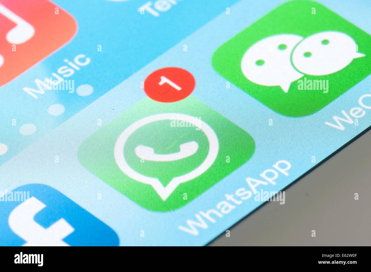 WhatsApp whats app logo icon in mobile screen Stock Photo