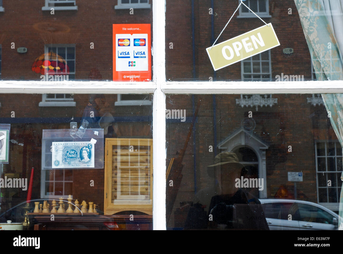 shop-window-and-open-sign-E63M7F.jpg