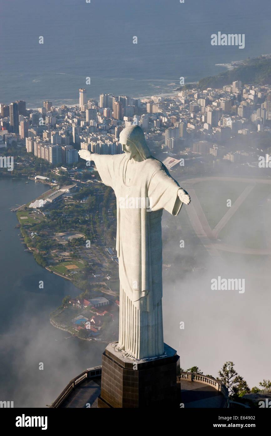 The giant Art Deco statue Jesus known as Cristo Redentor (Christ Redeemer) on Corcovado mountain in Rio de Janeiro - Stock Image