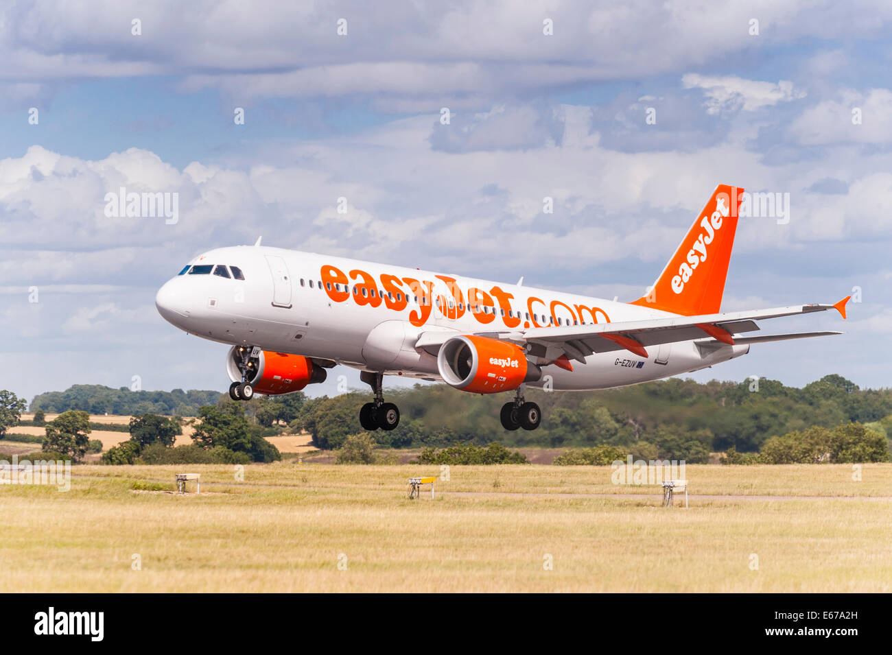 An easyJet Airbus A320 landing at Luton Airport in England , Britain , Uk Stock Photo