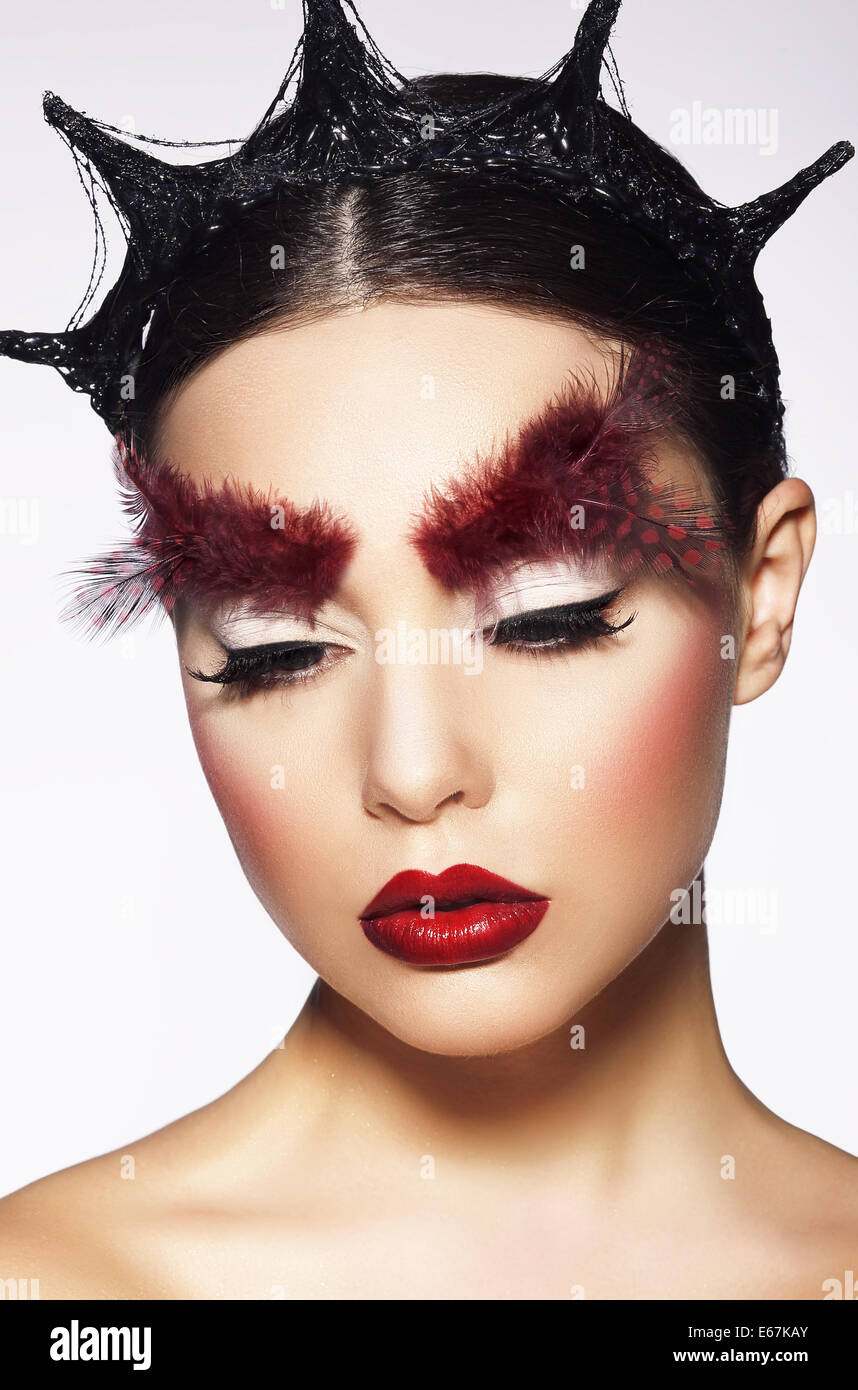 Glamor. Eccentric Woman with Surreal Theatrical Hairdress - Stock Image