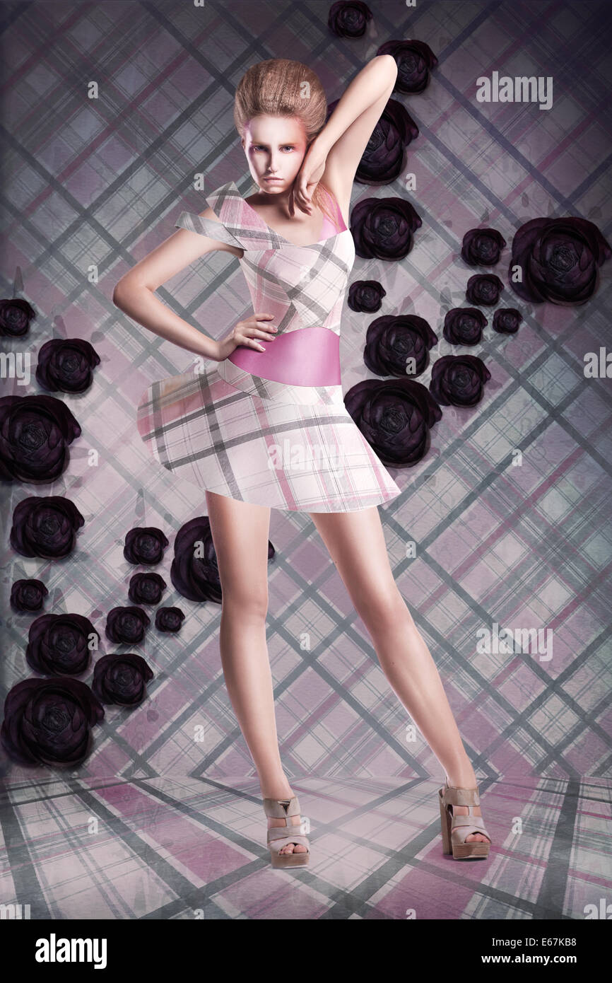 Modern Art. Woman in Checkered Dress over Abstract Background - Stock Image