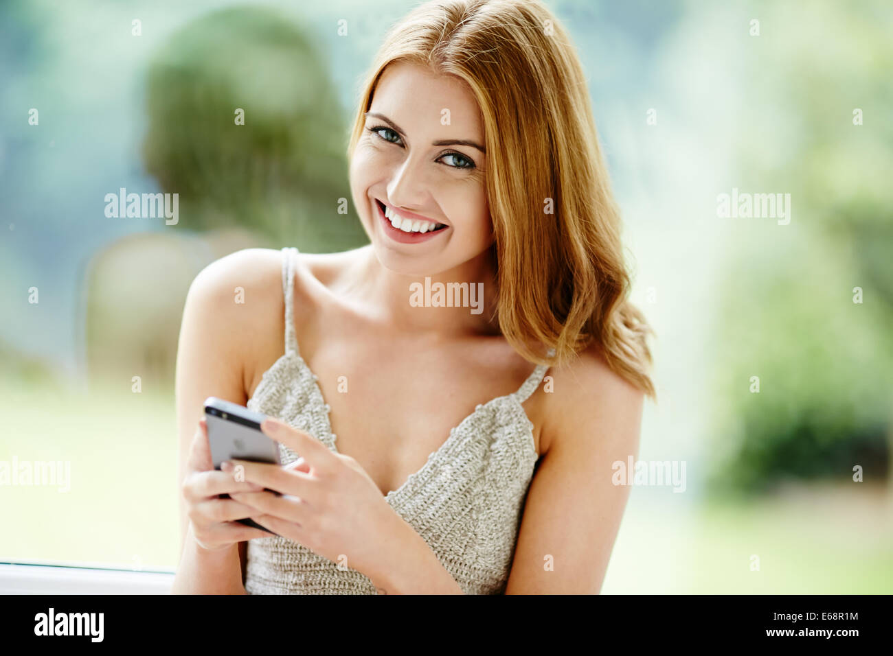 Pretty girl using mobile phone - Stock Image