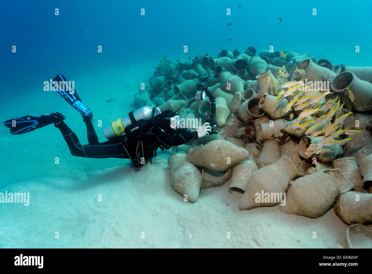 Underwater photographer photographing school of fish on amphora, Red Sea, Makadi Bay, Hurghada, Egypt - Stock Image