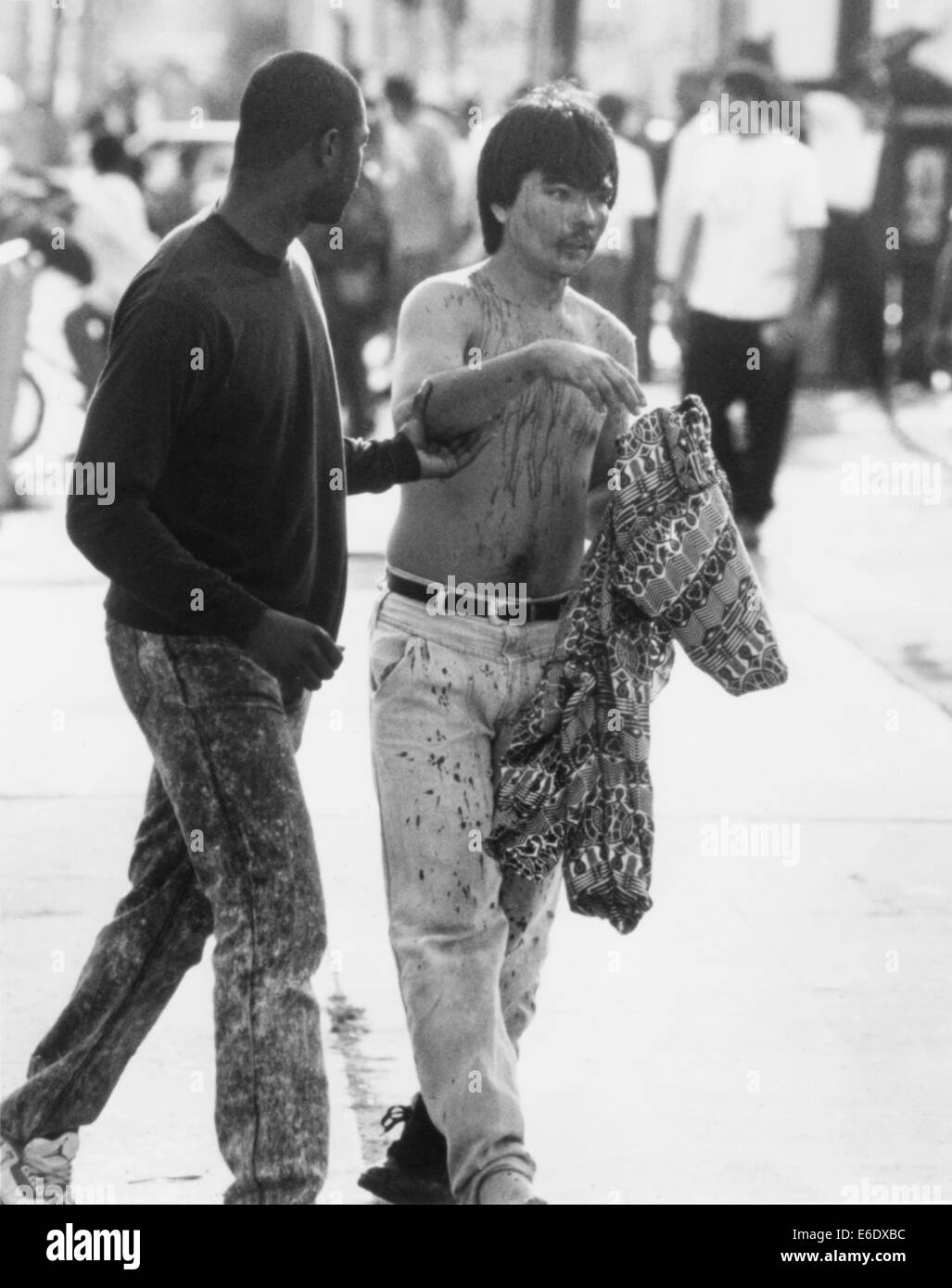 Bloodied Man Being Escorted to Safety During Riots Resulting from Rodney King's Verdict, Los Angeles, California, - Stock Image