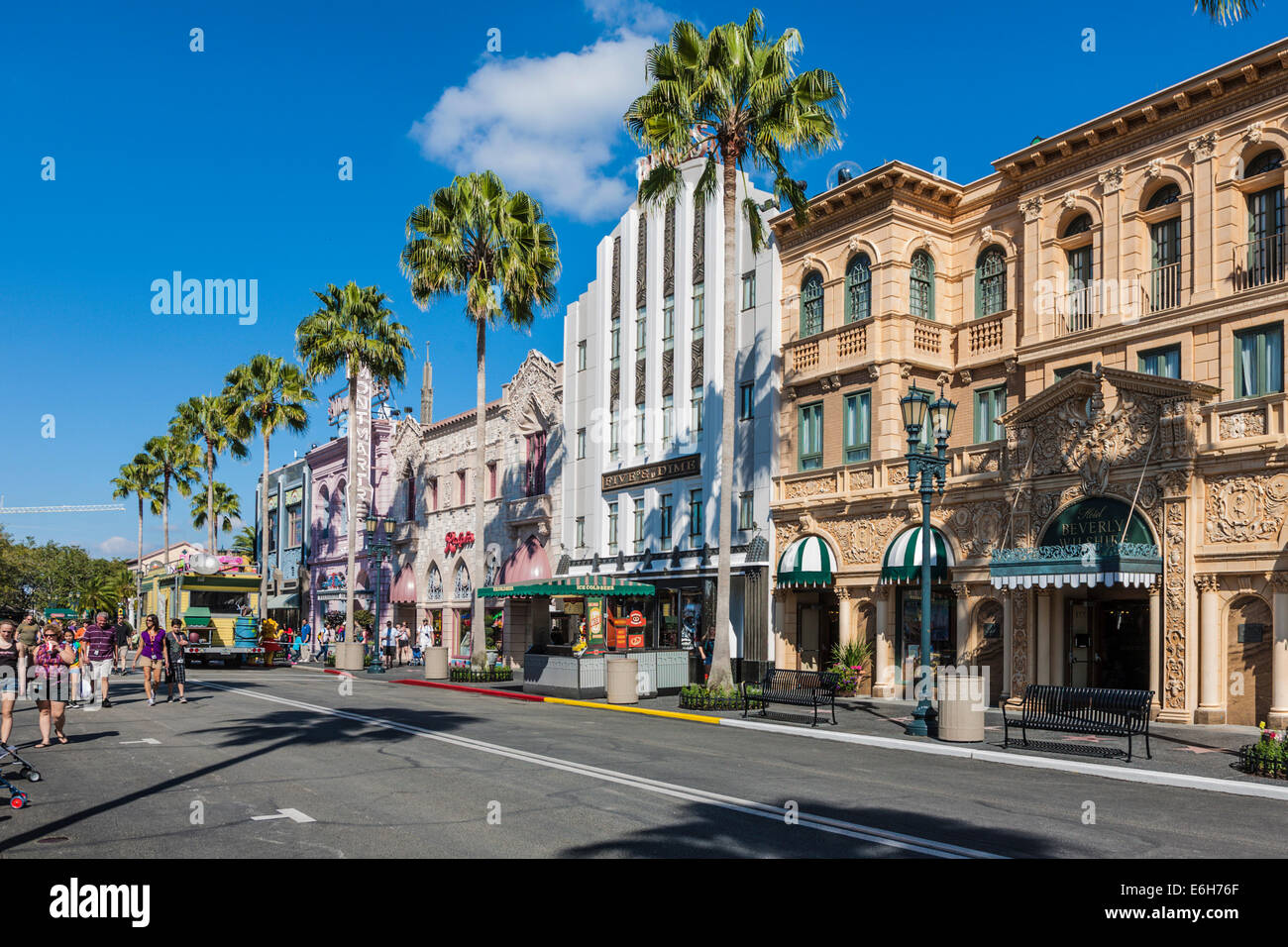 Tourists walk along Rodeo Drive in the Hollywood area of Universal Studios theme park in Orlando, Florida - Stock Image