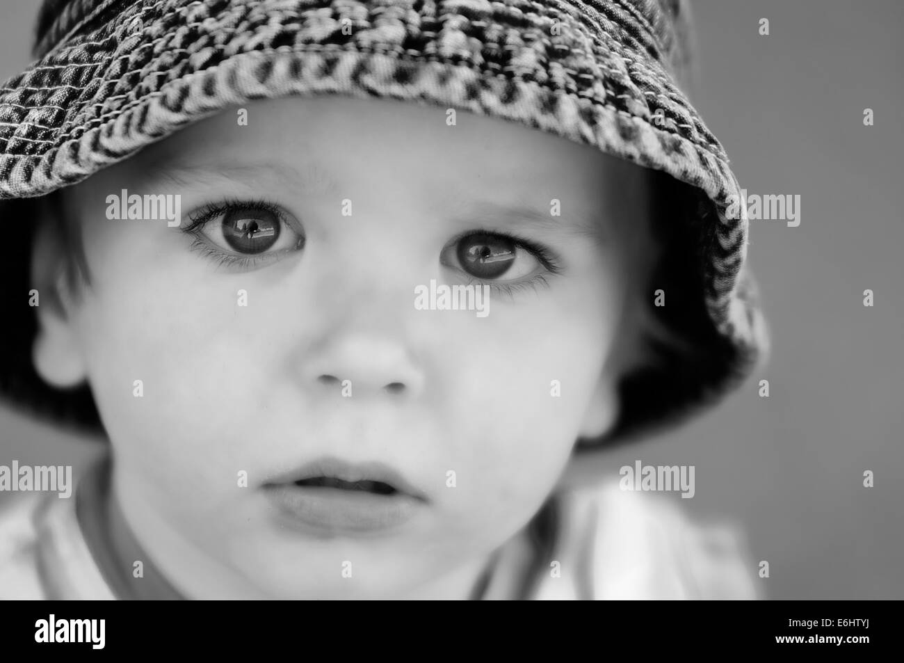 portrait-of-a-beautiful-2-yr-old-boy-looking-straight-into-the-camera-E6HTYJ.jpg