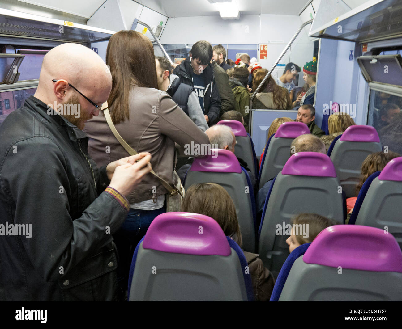 Manchester,Piccadilly,Oxford,rd,Road,Liverpool,Lime,St,street,suburban,urban,trains,packed,purple,seat,seats,backs,seatbacks,BR,British,Rail,britishrail,subsidy,city,centre,commuter,travel,travelers,revelers,people,going,to,work,morning,evening,dark,British,train,operating,company,owned,by,Serco,Gotonysmith,Serco-Abellio,Abellio,SercoAbellio,service,services,Britain,system,network,rail,railway,Cheshire,County Durham,Cumbria,Greater Manchester,Lancashire,Merseyside,Northumberland,Teesside,Tyne,and,Wear,and,Yorkshire.,Northerns,services,also,extend,to,the,north,Midland,counties,of,Derbyshire,Lincolnshire,Nottinghamshire,and,Staffordshire.,Most,services,are,supported,by,passenger,transport,executives.,Of,all,Train,Operating,Companies,in,the,UK,Northern,Rail,operates,the,most,stations,Serco-NedRailways,NedRailways,Class,142,Pacers,Secretary,of,State,for,transport,express,slower,route,routes,Operator,of,the,Year,2007,national,NR,150,150s,inside,interior,151,sprinter,sprinters,Diesel,multiple,unit,units,electric