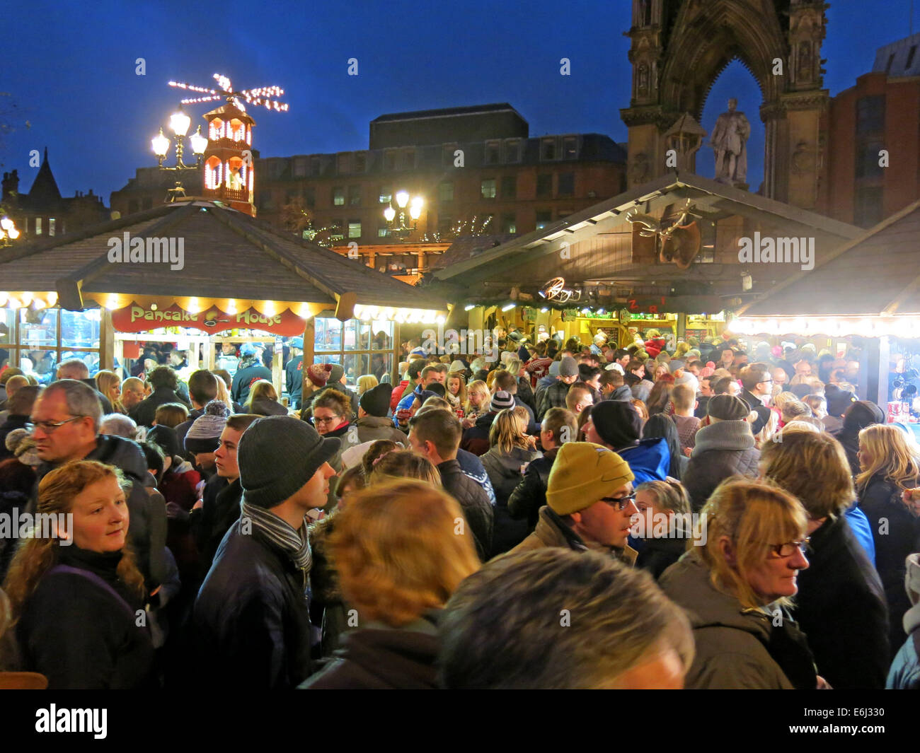 night,sq,market,town,hall,santa,on,clock,NW,north,west,evening,crowd,crowds,shopping,food,drink,German,Markets,in,Albert,Square,December,at,dusk,happy,enjoying,themselves,festive,trip,into,the,city,town,fun,happy,German,Markets,in,Albert,Square,December,at,dusk,Lancs,Lancashire,tour,tourist,Gotonysmith,tourism,trip,buy,buying,presents,wurst,sausages,cooking,cooked,food,all,ages