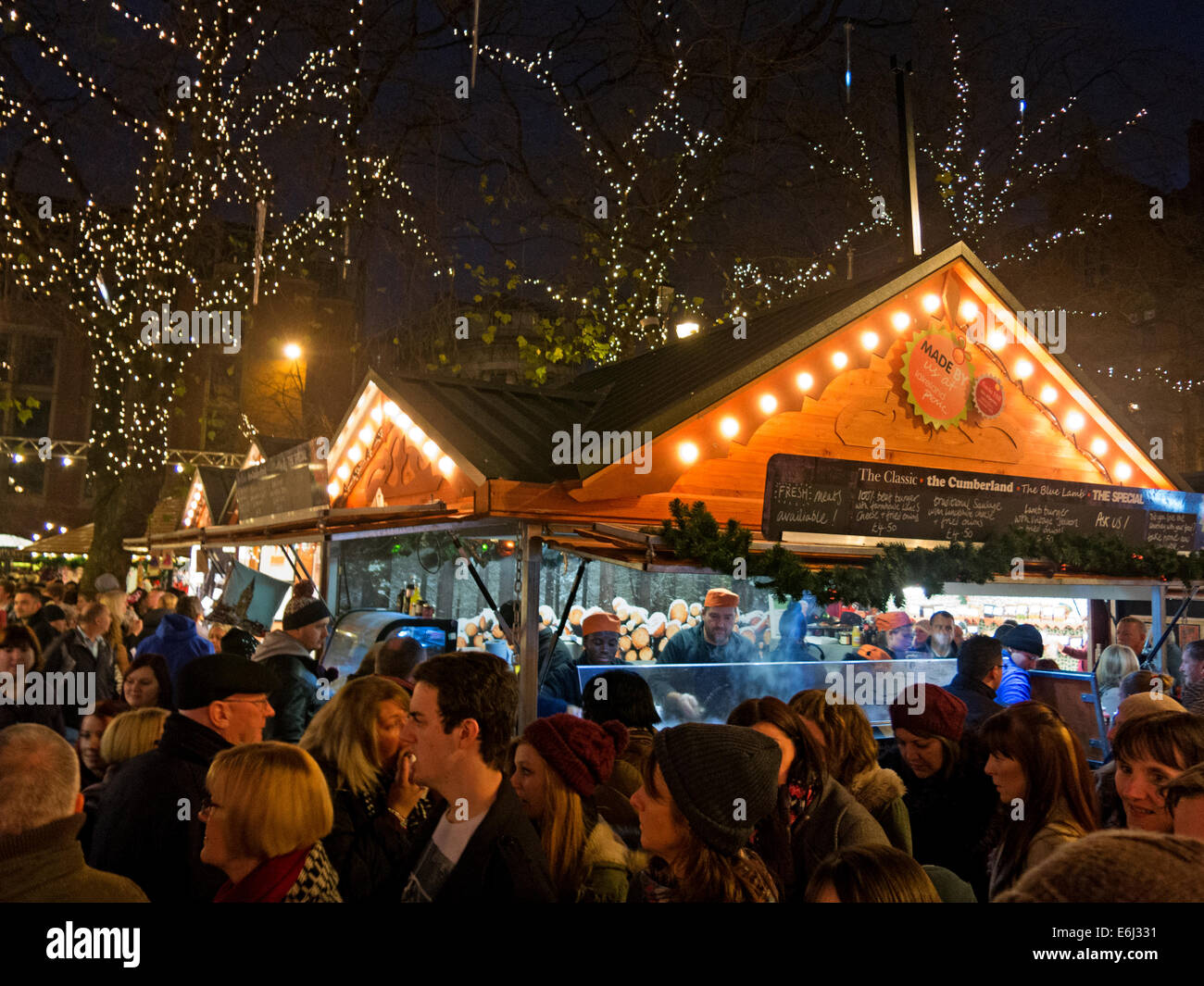night,sq,market,town,hall,santa,on,clock,NW,north,west,evening,crowd,crowds,shopping,food,drink,German,Markets,in,Albert,Square,December,at,dusk,happy,enjoying,themselves,festive,trip,into,the,city,town,fun,happy,German,Markets,in,Albert,Square,December,at,dusk,Lancs,Lancashire,tour,tourist,Gotonysmith,tourism,trip,buy,buying,presents,wurst,sausages,cooking,cooked,food,wooden,hut,huts,shed,sheds,all,ages