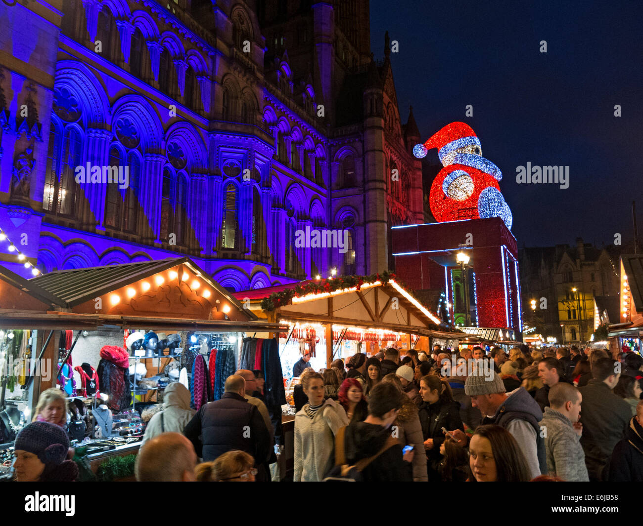 Xmas,Manc,mancunian,night,evening,November,Dec,Nov,townhall,sq,GB,British,Great,Britain,English,traditional,tradition,german,germany,markets,stalls,European,Santa,on,town,hall,Albert,Square,England,UK,lit,up,public,building,city,centre,shopping,shops,present,people,crowd,at,family,sausages,wurst,Gotonysmith,Buy Pictures of,Buy Images Of