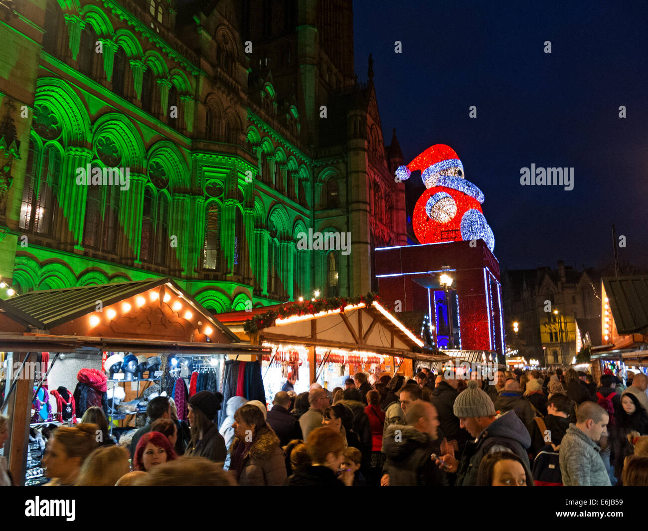 at,dusk,northwest,north,west,England,GB,Great,Britain,GreatBritain,stalls,continental,German,European,townhall,town,hall,festive,tourist,attraction,popular,bringing,together,of,people,party,manc,Mancunian,distinct,character,and,atmosphere,Gotonysmith,lights,nightlights,father,xmas,Attracting,shoppers,from,all,over,the,UK,and,beyond,the,market,has,put,Manchester,city,centre,firmly,on,the,Christmas,map,–,the,Christmas,Market,has,become,not,just,a,fabulous,place,to,shop,but,also,a,hugely,popular,leisure,destination,in,its,own,right.,No,Mancunian,winter,is,complete,without,a,wander,through,the,chalet-lined,streets,of,the,markets.,The,Christmas,Markets,are,located,in,different,spaces,around,the,city,each,with,its,own,distinct,character,and,atmosphere,Albert,Square,|,Brazennose,Street,|,St,Anns,Square,|,Exchange,Street,|,New,Cathedral,Street,|,The,Corn,Exchange,|,Corporation,Street,The,array,of,over,300,stalls,is,mind-boggling,with,mouthwatering,delicacies,from,all,over,Europe.,The,choice,is,getting,bigger,and,bigger,and,includes,gifts,crafts,jewellery,clothes,toys,Buy