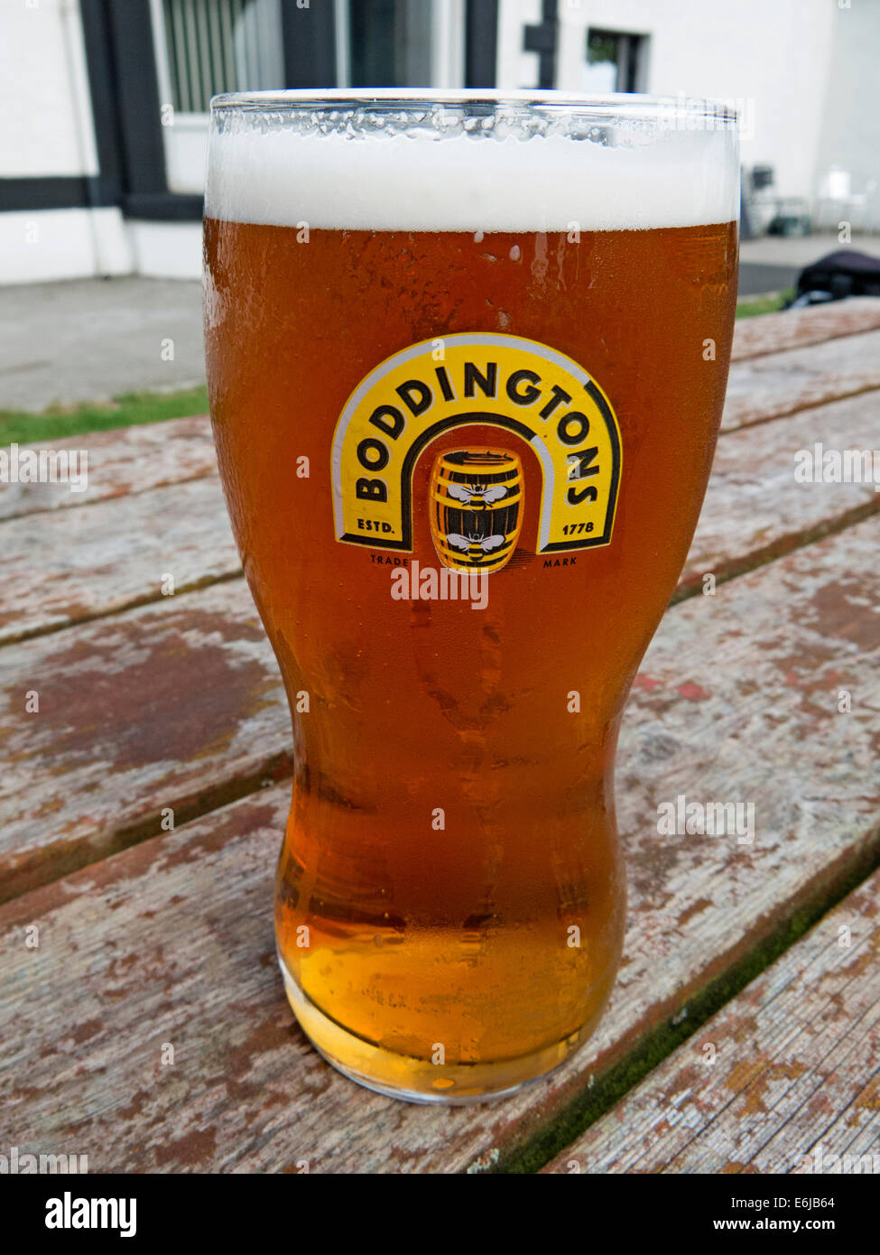 with,a,head,withahead,beer,Boddington,regional,ale,brewed,in,Mossside,pint,glass,boddies,hoppy,widget,draught-style,draught,style,cream,brewing,co,company,Strangeways,whitbread,Anheuser–Busch,InBev,outside,on,a,bench,table,wood,wooden,cask,conditioned,Pub,barrel,regional,national,Madchester,Gotonysmith,the,of,creamOfManchester,bee,bees,logo,city,product,NW,England,UK,GB,Great,britain,Anheuser,Busch,Hydes,Brewery,in,Moss,Side,Kestrel,kegging,facility,prison,HMP,demolished,blandly,foamy,nitrokeg,travesty,of,the,original,version