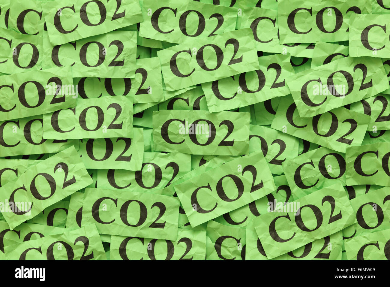 Pile of green paper notes with word 'CO2' (Carbon Dioxide). - Stock Image