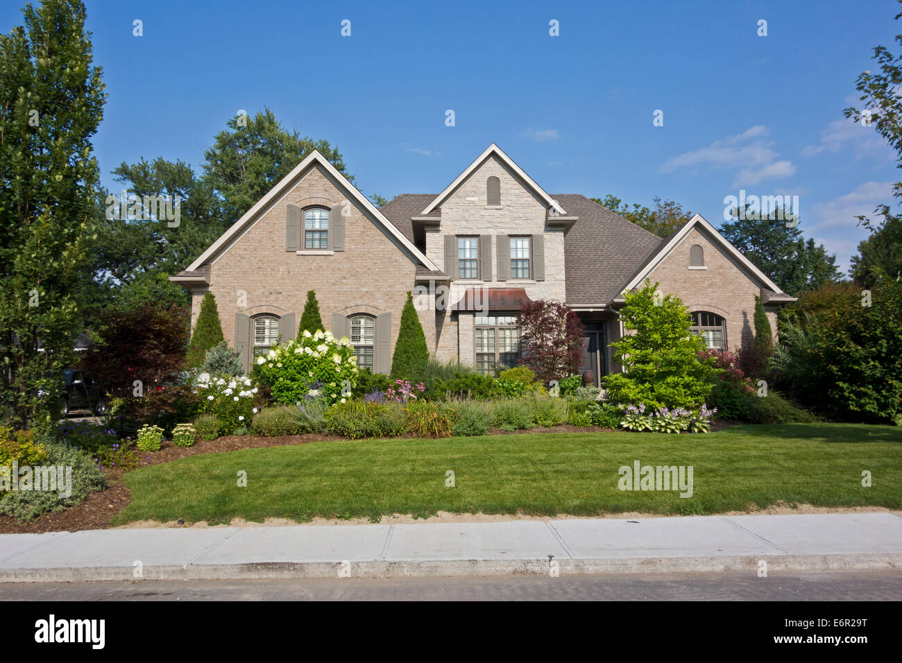 Attractive older and wealthy home with landscaped yard and flowers in St. Catharines, Ontario, Canada. - Stock Image