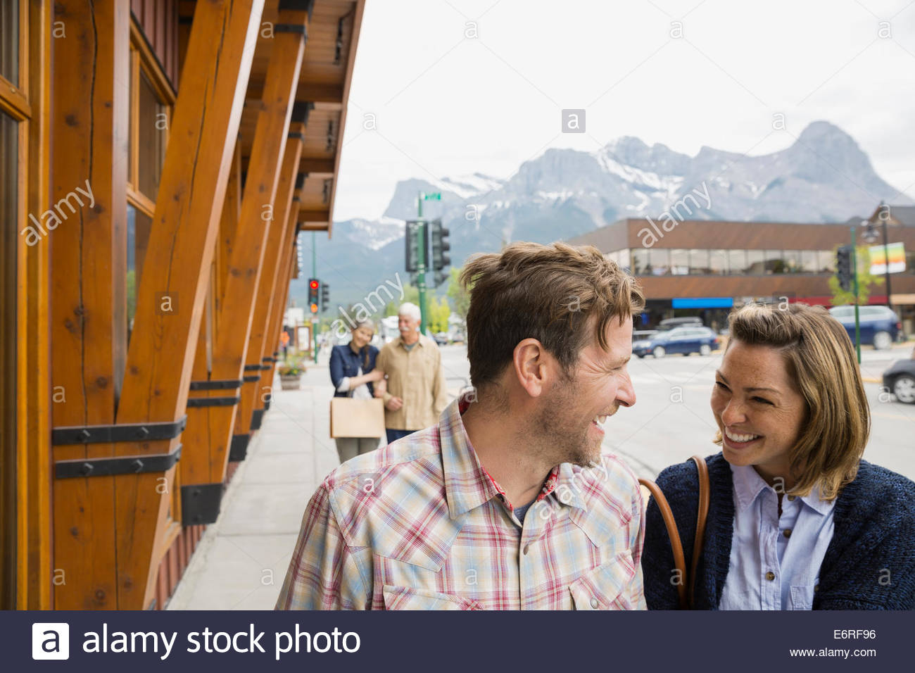 Couple walking on village street - Stock Image