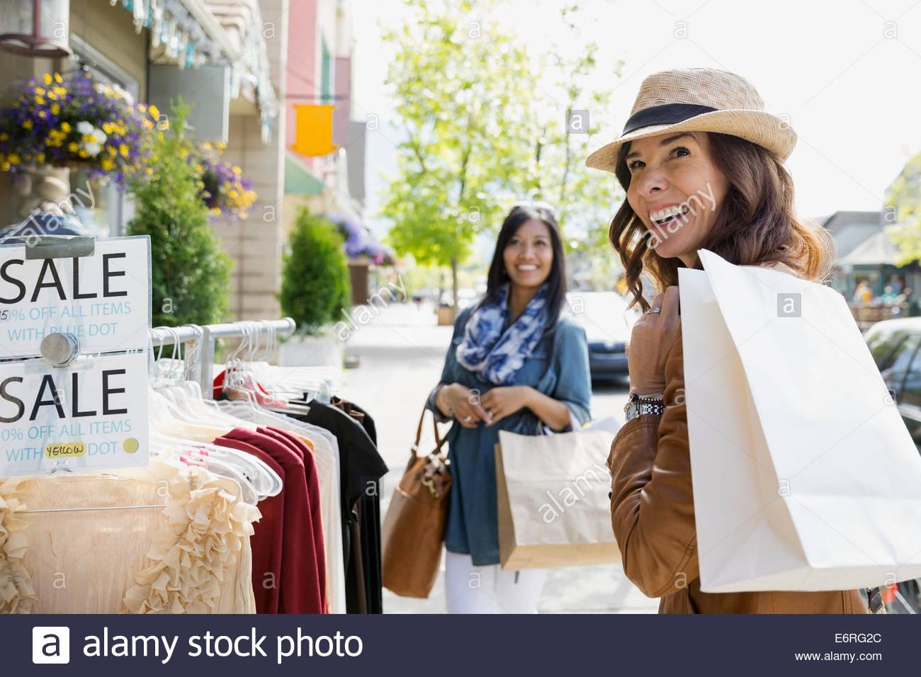 Women shopping on village street - Stock Image