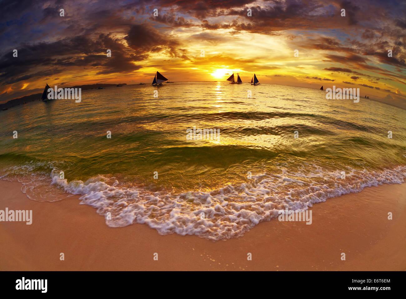 Tropical beach at sunset, Boracay island, Philippines, fisheye shot - Stock Image
