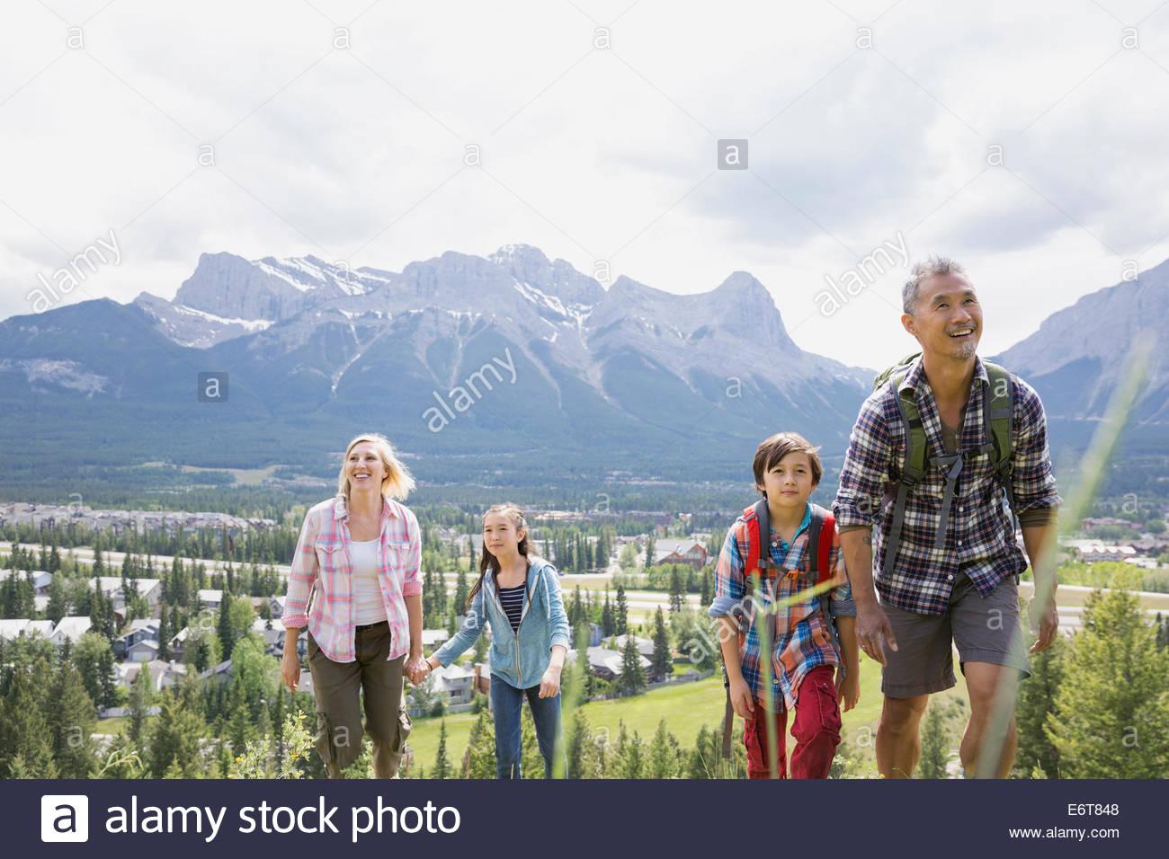 Family hiking on rural hillside - Stock Image