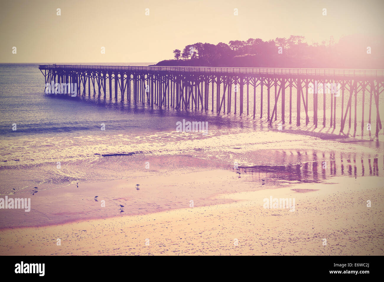 Vintage wood bridge at beach sunset, California, USA. - Stock Image