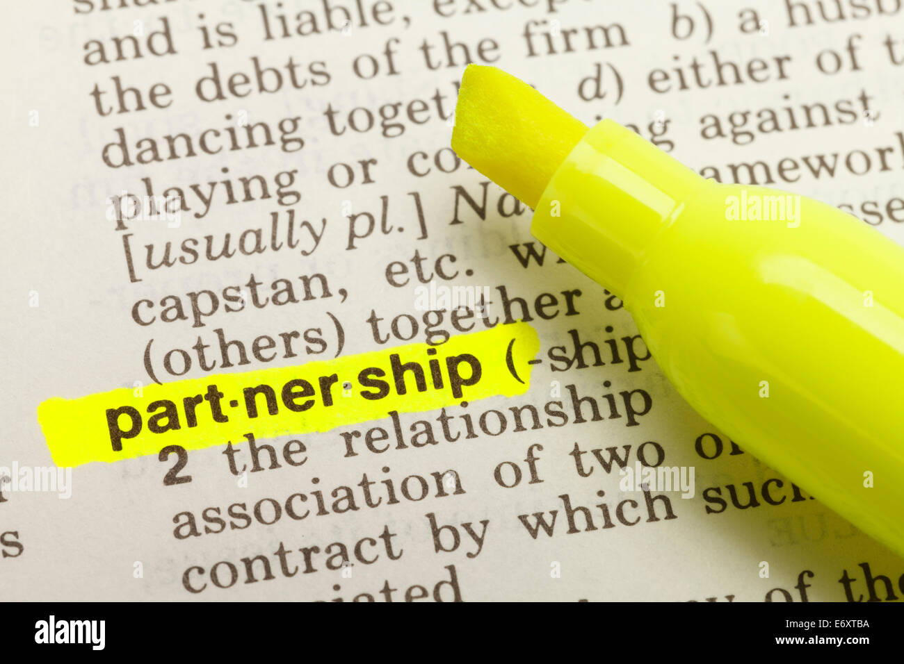 The Word Partnership Highlighted in Dictionary with Yellow Marker Highlighter Pen. - Stock Image