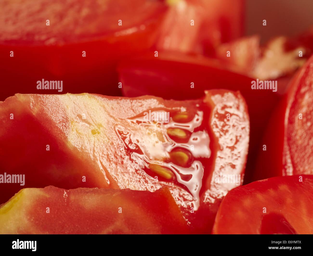 Wedges of ripe tomato - Stock Image