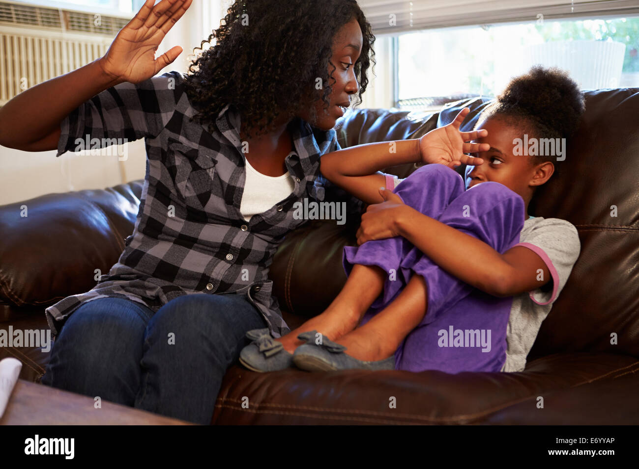 Mother Being Physically Abusive Towards Daughter At HomeStock Photo