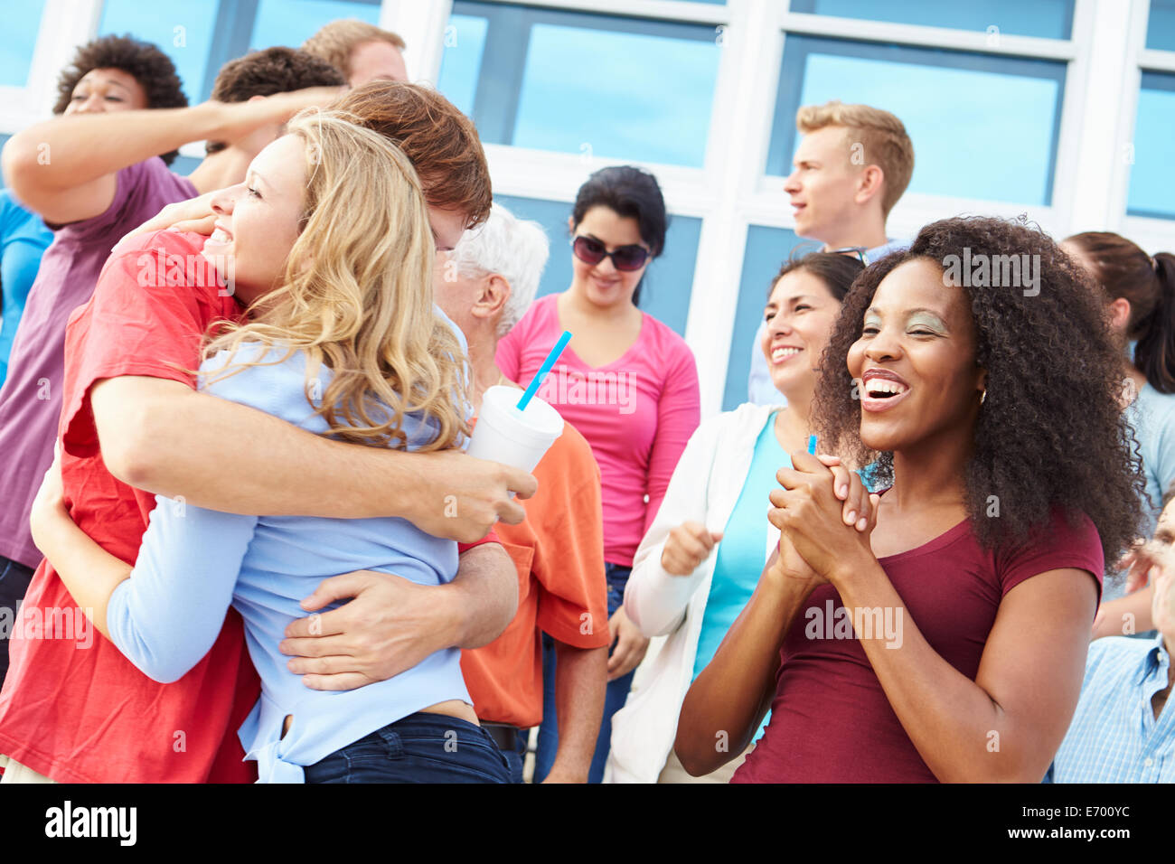 Spectators Celebrating At Outdoor Sports Event - Stock Image
