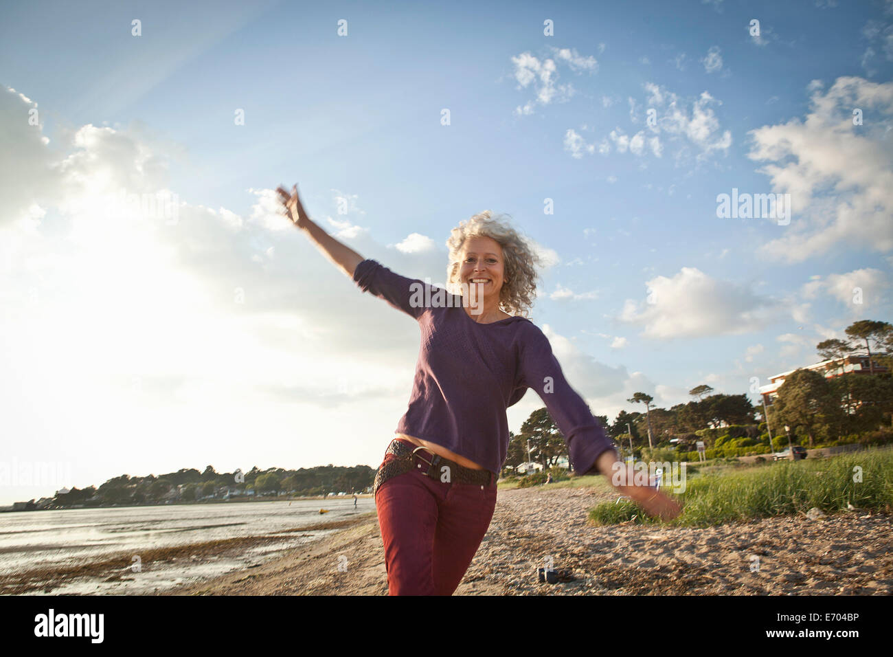 Mature woman enjoying beach - Stock Image