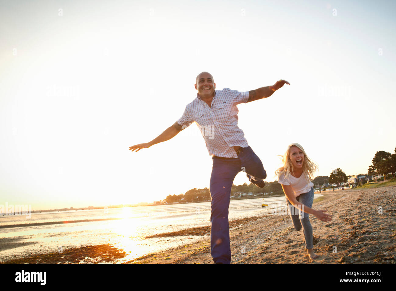 Couple having fun on beach - Stock Image