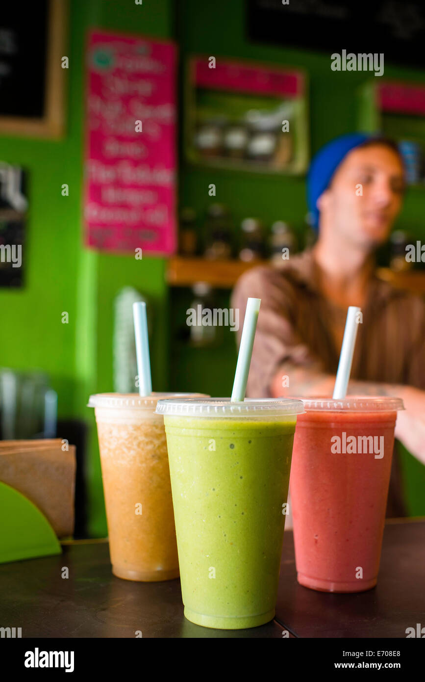 Organic smoothies on table in cafe - Stock Image