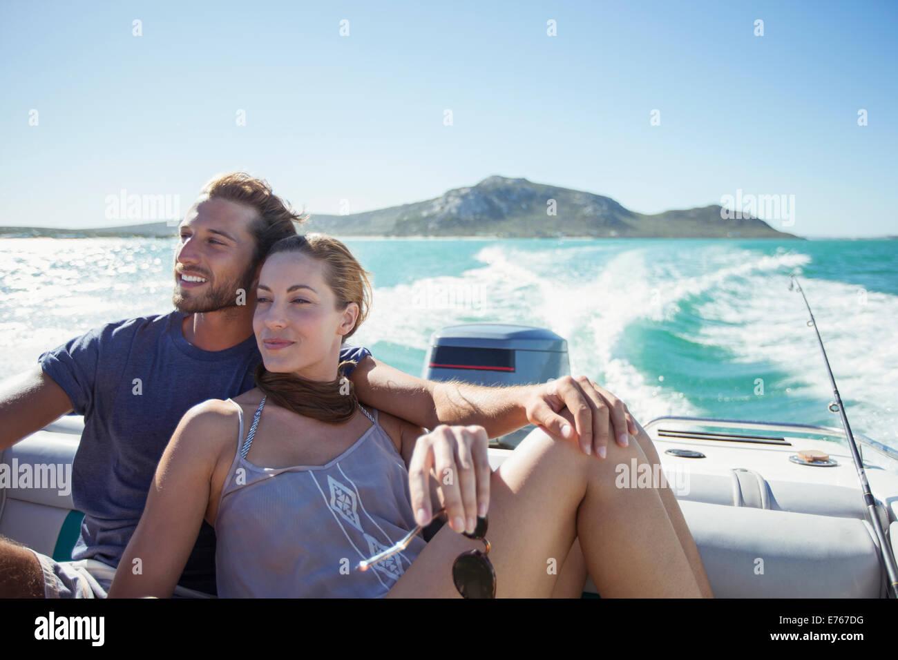 Couple sitting on boat together - Stock Image