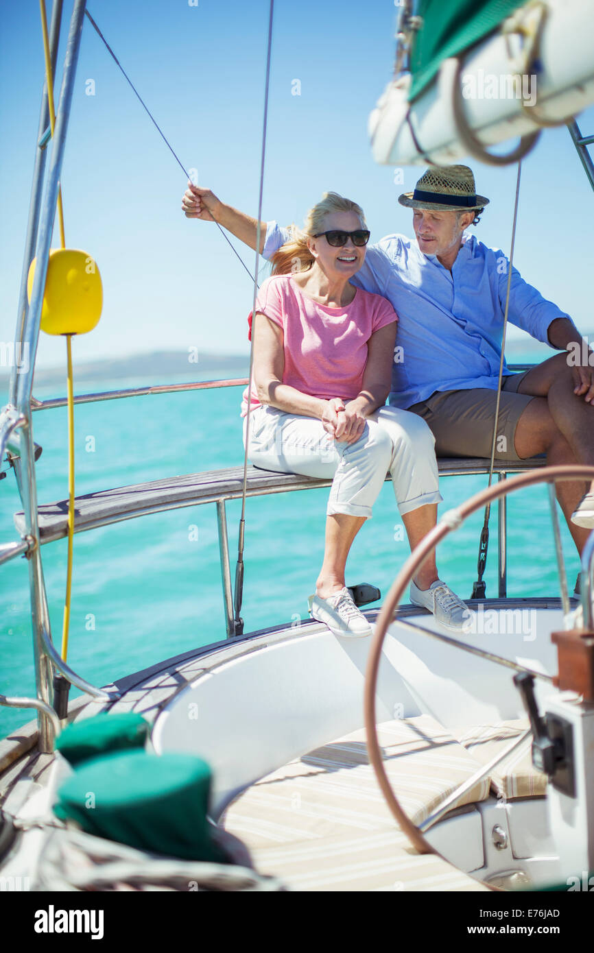 Couple sitting in boat together on water - Stock Image