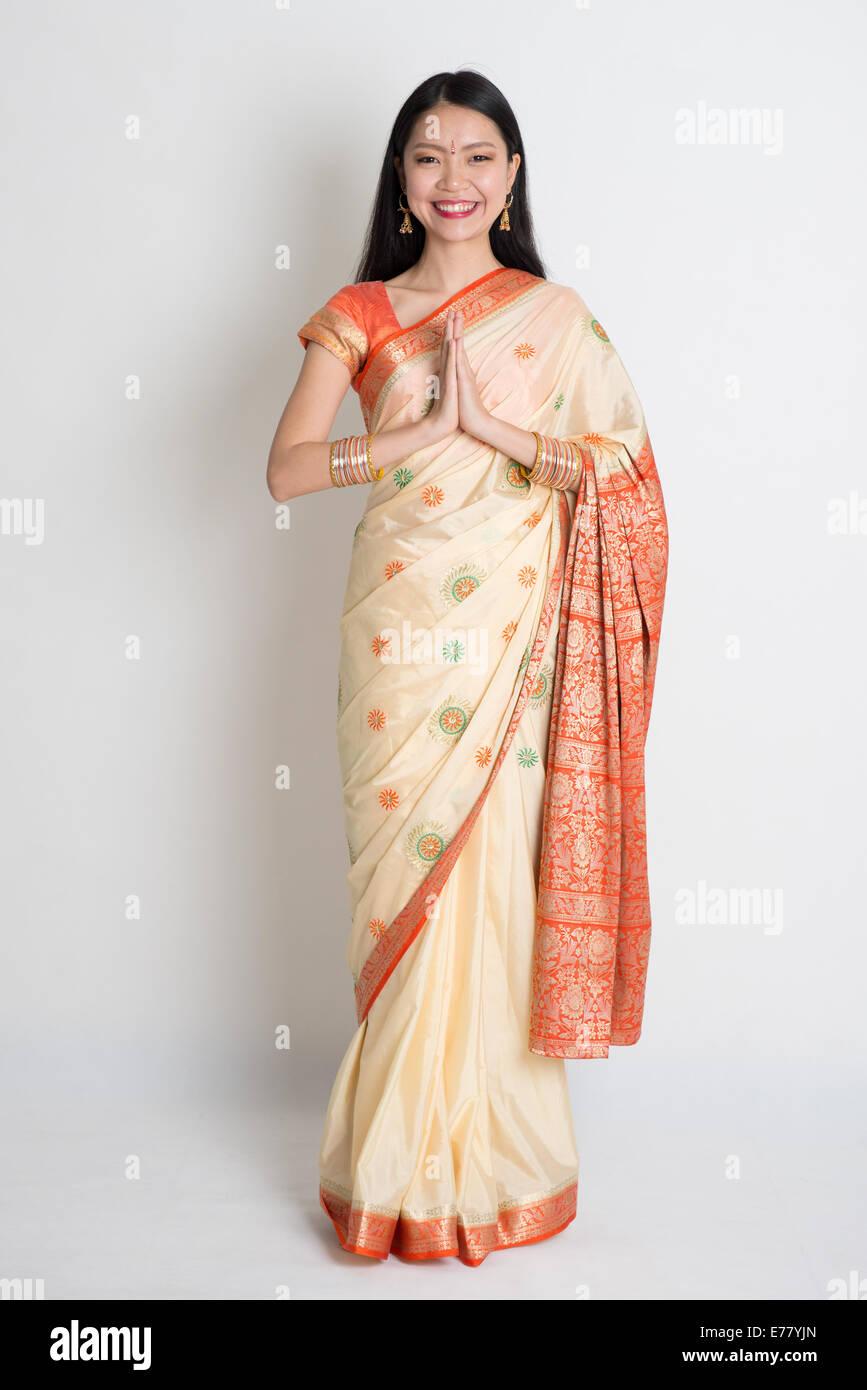 Asian Indian Girl In A Greeting Pose Traditional Sari Costume Full