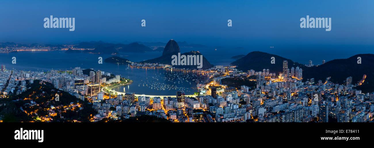 the bay, city and Sugar Loaf Mountain at dusk, Rio de Janeiro, Brazil - Stock Image