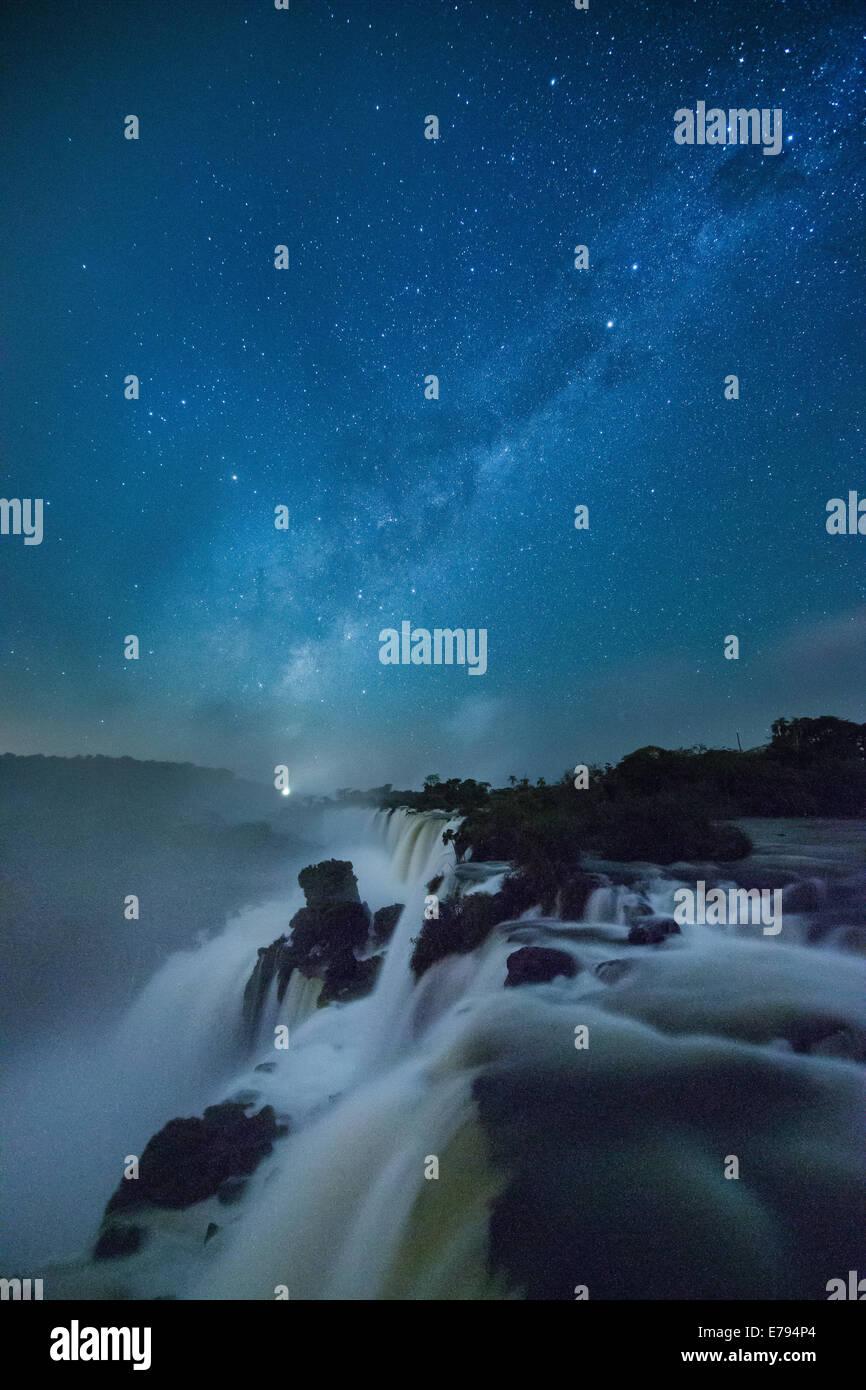 the Milky Way over Iguazu Falls at night, Argentina - Stock Image